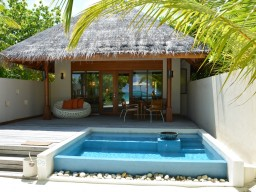 Beach Bungalow - Exterior view of a beach bungalow from the beach with private pool.