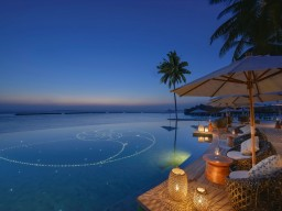 The Nautilus Maldives - Romantic setting by the pool.