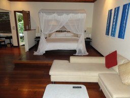 Deluxe Beachfront Pool Villa  - Room example with tasteful and comfortable interior.