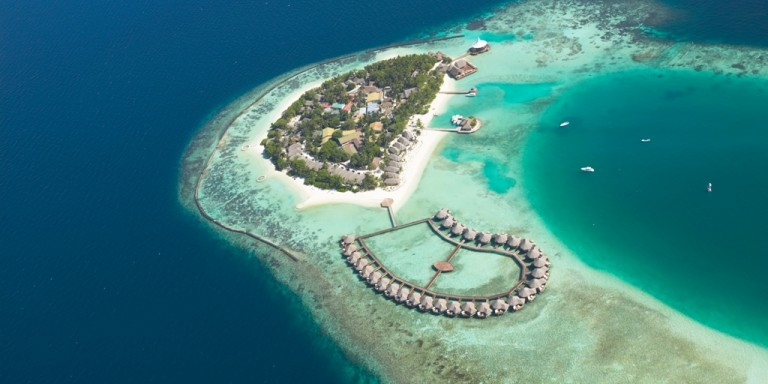 Bird view of the water villas - In harmony with the lagoon of the island you can see the luxury water villas.